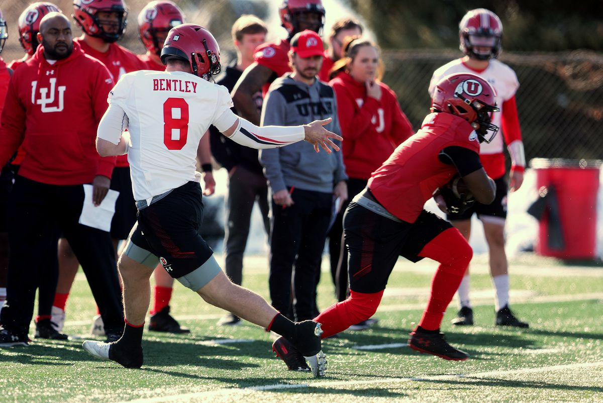 Quarterback Jake Bentley hands the ball to running back Jordan Wilmore during a drill as the University of Utah football team opens spring camp in Salt Lake City on Monday, March 2, 2020.