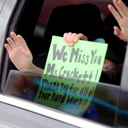 Students at Farr West Elementary in Farr West, Weber County, hold signs and wave at teachers during a drive-by parade in front of the school on the last day of classes on Friday, May 15, 2020.
