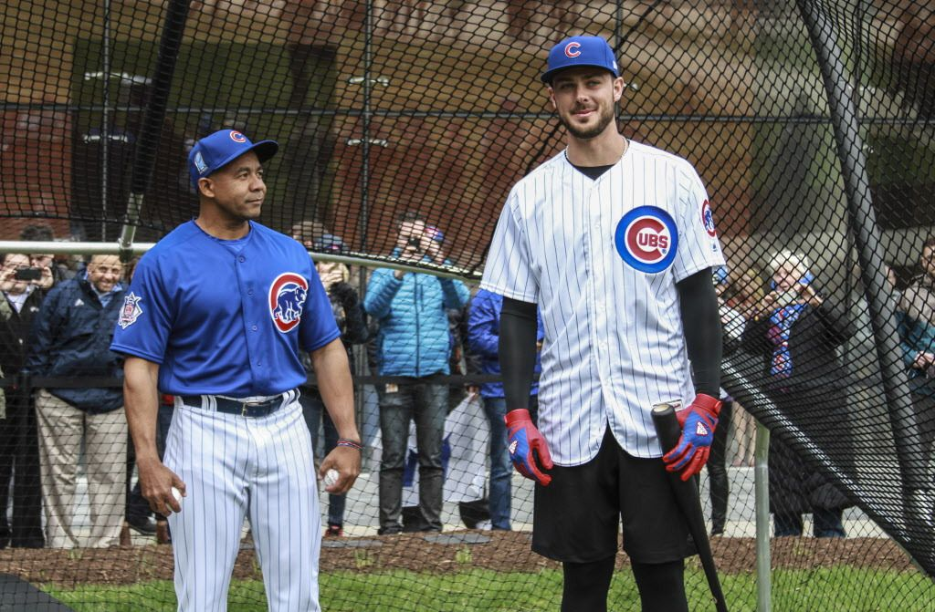"""From left, Juan Cabreja, Chicago Cubs hitting coach and Kris Bryant, third baseman, stands in preparation of """"practice"""" in front of fans at 444 W. Lake St. 