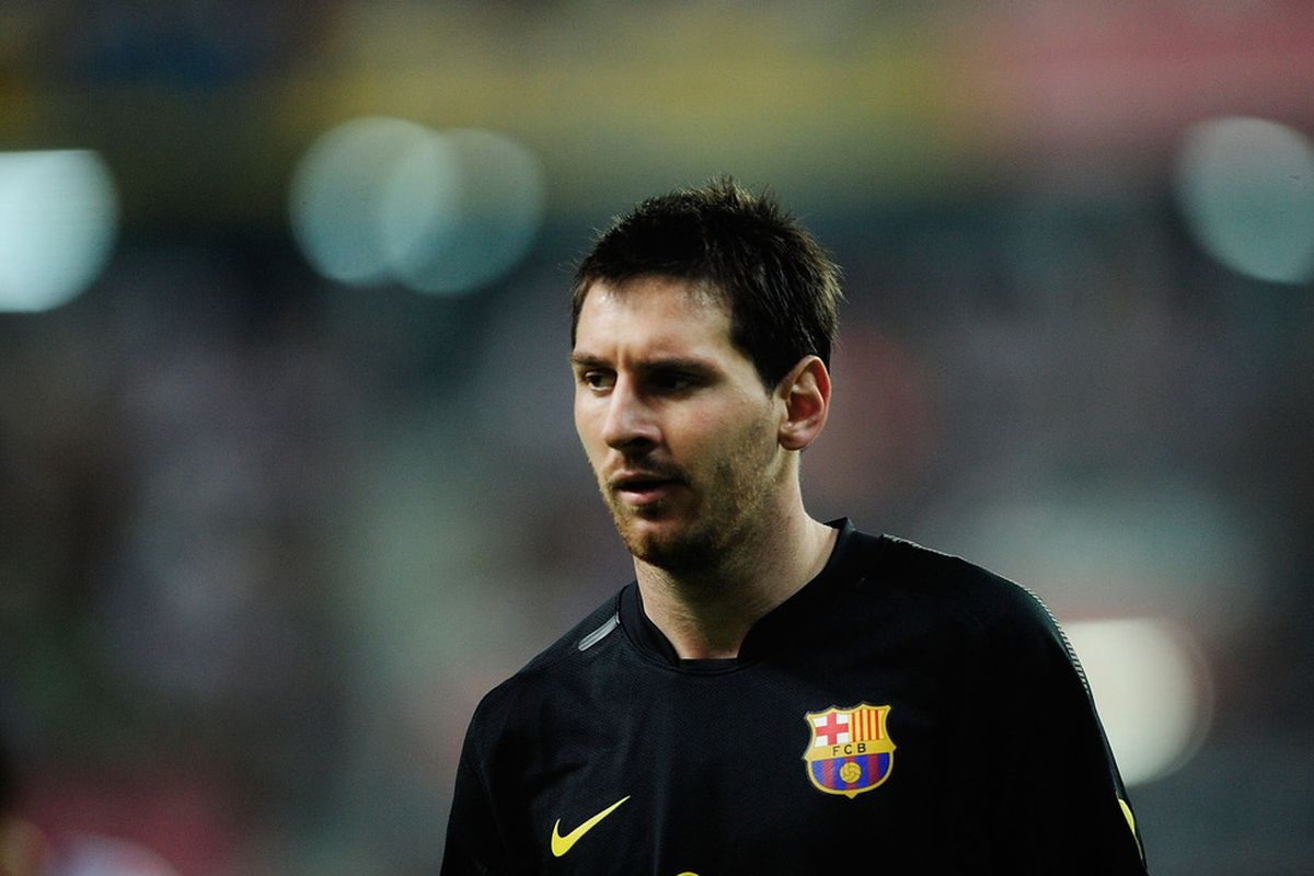 GIJON, SPAIN - OCTOBER 02: Leo Messi of FC Barcelona looks on during the La Liga match between Real Sporting de Gijon and FC Barcelona at Estadio El Molinon on October 2, 2011 in Gijon, Spain.  (Photo by Denis Doyle/Getty Images)