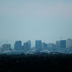 The sun sets over Salt Lake City on Thursday, Aug. 5, 2021. Utah air quality regulators say smoke from the West Coast will bring significantly lower air quality to much of Utah Friday.