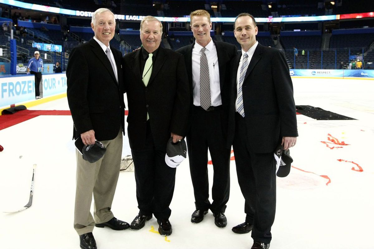 The BC coaching staff posing after winning the Frozen Four in Tampa last season.