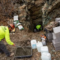 Bart Walker, left, mixes concrete as he and Landon Duckworth work to close a mine tunnel opening above Layton on Wednesday, Nov. 18, 2020. The company they work for, Strong Solutions, was contracted by the Utah Division of Oil, Gas and Mining to close the mine.