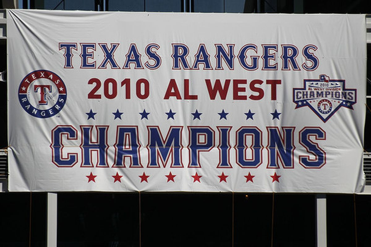 ARLINGTON TX - SEPTEMBER 29:  A Texas Rangers AL West champions banner hangs at Rangers Ballpark in Arlington on September 29 2010 in Arlington Texas.  (Photo by Ronald Martinez/Getty Images)