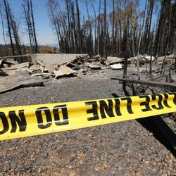 The remains of a home destroyed by the Brian Head Fire are pictured on Friday, June 30, 2017. The evacuation order for Brian Head and Dry Lakes was lifted Friday, 13 days after residents were forced from their homes by the raging fire.