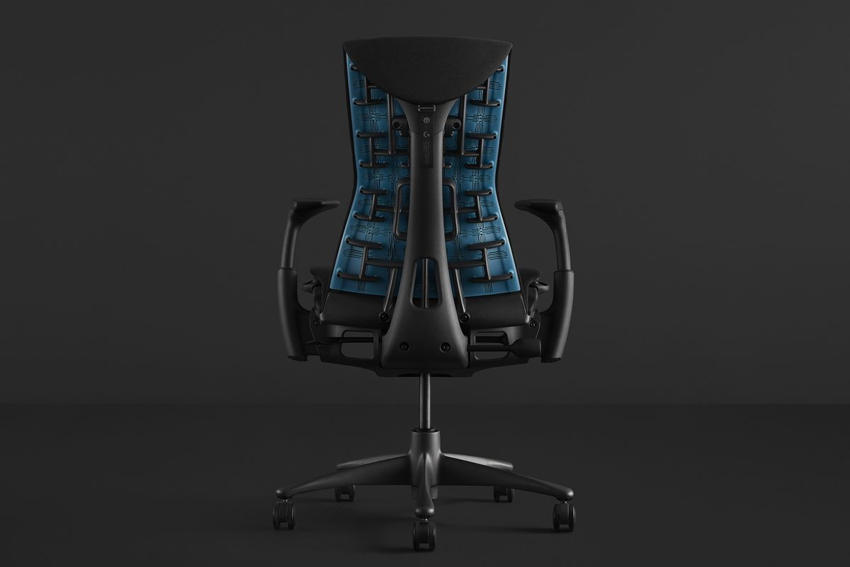 An Embody Gaming Chair, in black, with a bright blue support on the back.