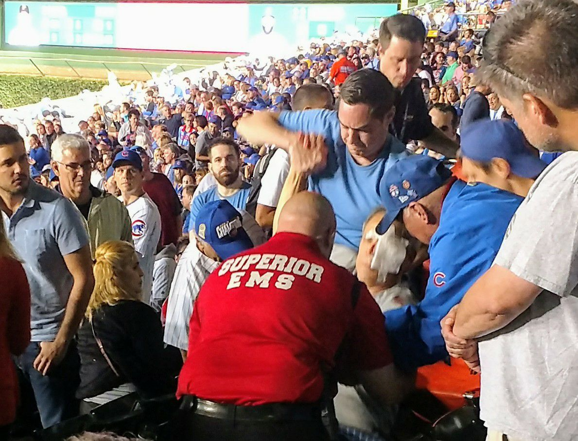 """John """"Jay"""" Loos is taken from the seating area after being struck by a foul ball at Wrigley Field.   Provided"""