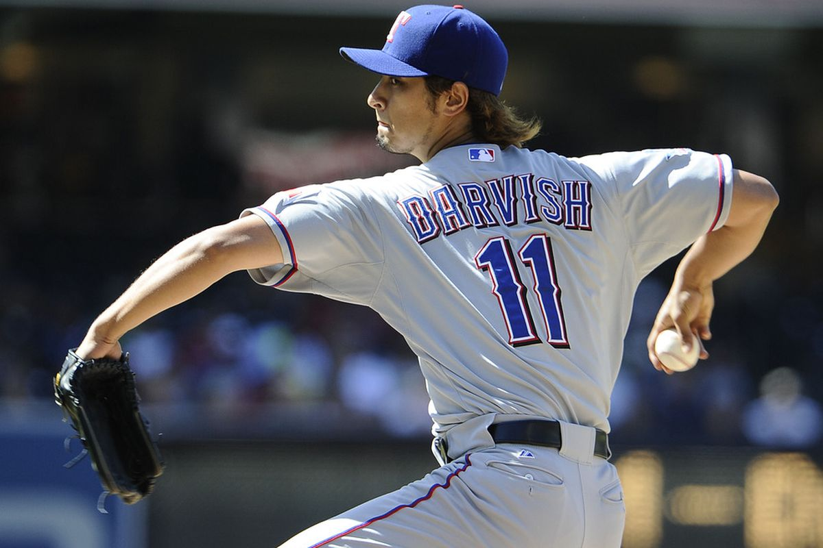 SAN DIEGO, CA - JUNE 20:  Yu Darvish #11 of the Texas Rangers pitches during the second inning of an interleague baseball game against the San Diego Padres at Petco Park on June 20, 2012 in San Diego, California.  (Photo by Denis Poroy/Getty Images)