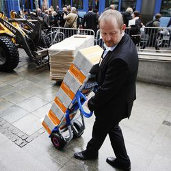 A man delivers boxed copies of the second report, of some 300 pages, regarding the mental health of Anders Behring Breivik, to the court in Oslo, Norway, Tuesday, April 10, 2012.  According to the new psychiatric assessment report, the right-wing extremist, Anders Breivik, who has confessed to killing 77 people in a bomb and shooting rampage in Norway on July 22, 2011, is not criminally insane,  contradicting an earlier assessment.