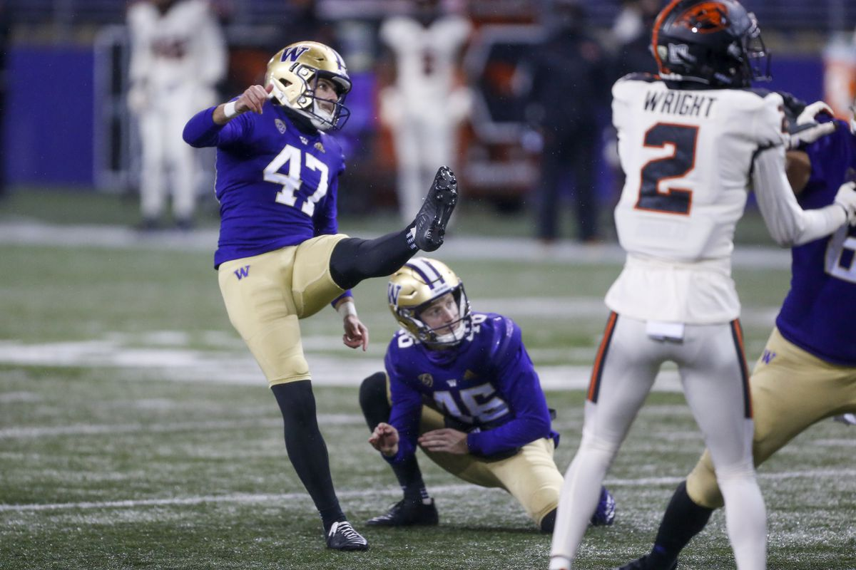 Washington Huskies place kicker Peyton Henry and holder Race Porter watch a successful field goal attempt against the Oregon State Beavers during the fourth quarter at Alaska Airlines Field at Husky Stadium.