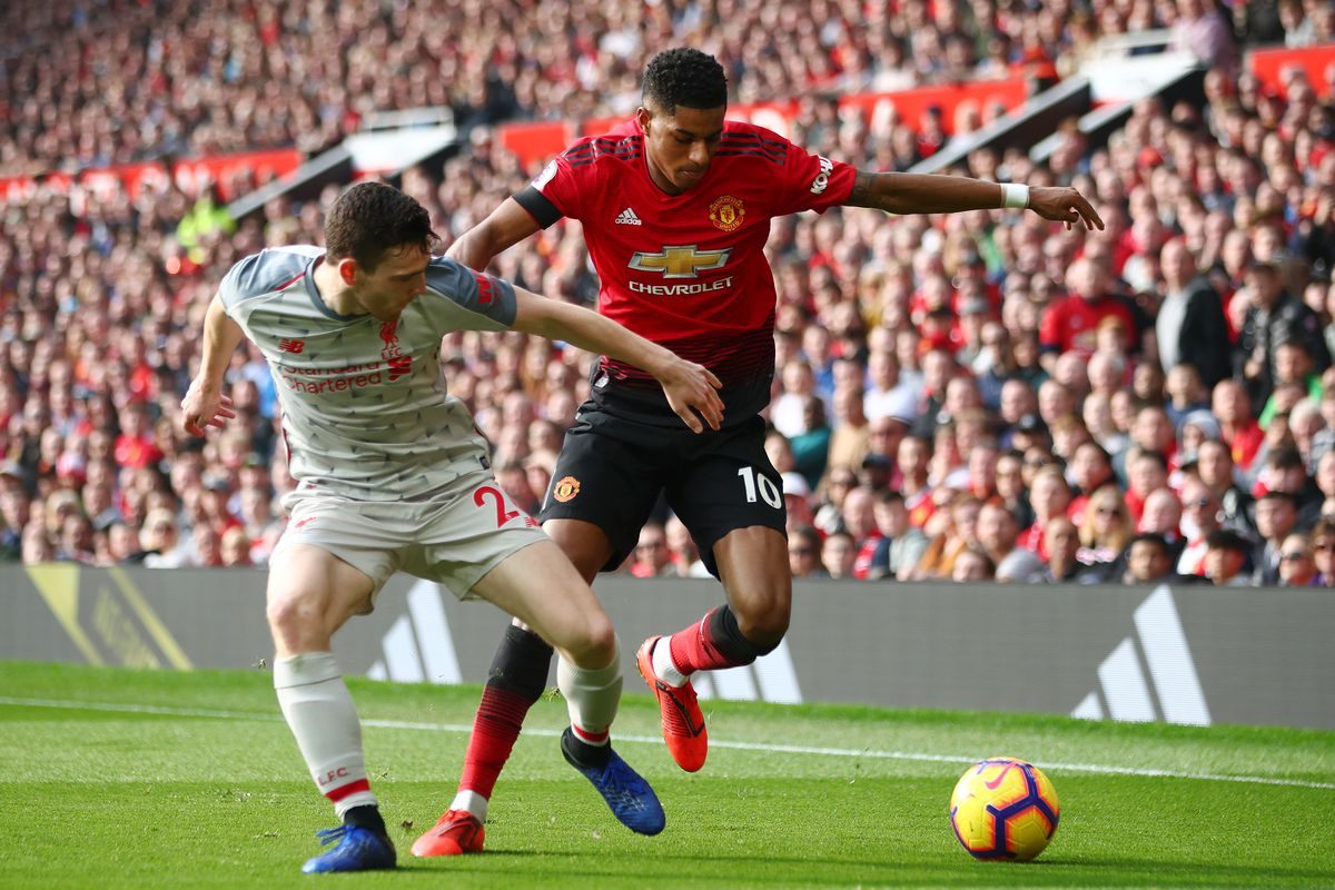 Marcus Rashford of Manchester United battles for possession with Andy Robertson of Liverpool FC - Premier League