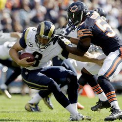 St. Louis Rams quarterback Sam Bradford (8) is sacked by Chicago Bears linebacker Nick Roach (53) in the second half of an NFL football game in Chicago, Sunday, Sept. 23, 2012. The Bears won 23-6.