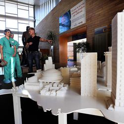 Sculptor Mark Revels, right, answers questions about his sugar cube sculptures that map iconic buildings across the country on Monday, July 18, 2016. The sculptures are on display at Intermountain Medical Center in Murray. Revels and fellow sculptor Brendan Jamison displayed their work to raise awareness on how to manage sugar intake for a healthy lifestyle.