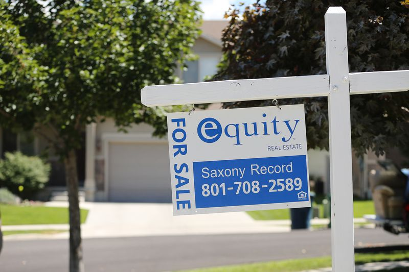 A for sale sign is pictured in Sandy on Friday, Aug. 11, 2017. The Salt Lake Board of Realtors reported Thursday that Wasatch Front existing home prices reached their highest point ever during a second quarter period, with the median single-family home price climbing to $300,000 — up from $275,000 the same time last year.