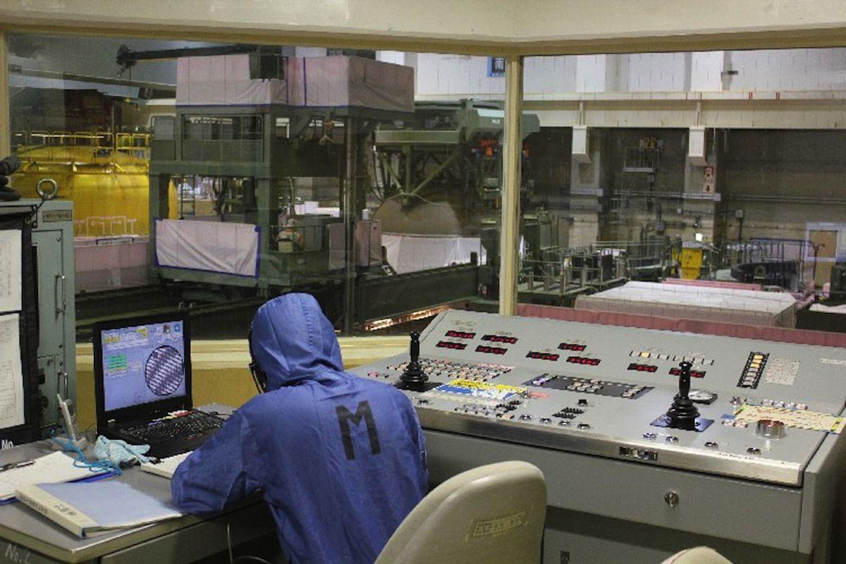 Fukushima reactor control room, suit (Credit: TEPCO)