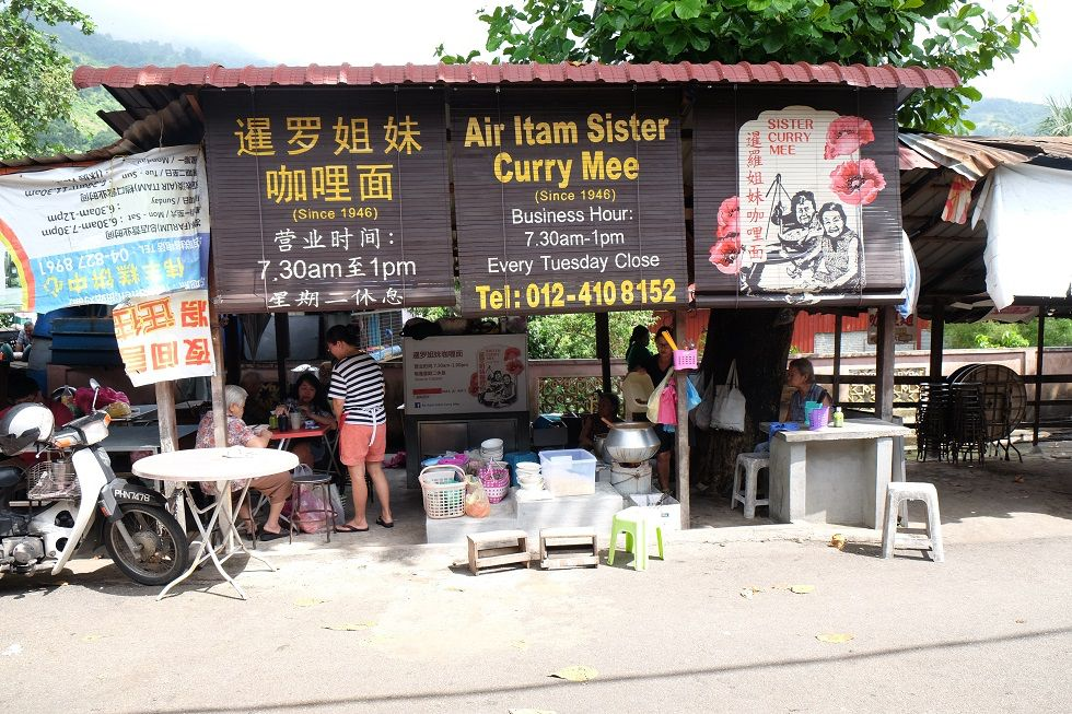 A curry mee/laksa stand at the Air Itam Market in Penang