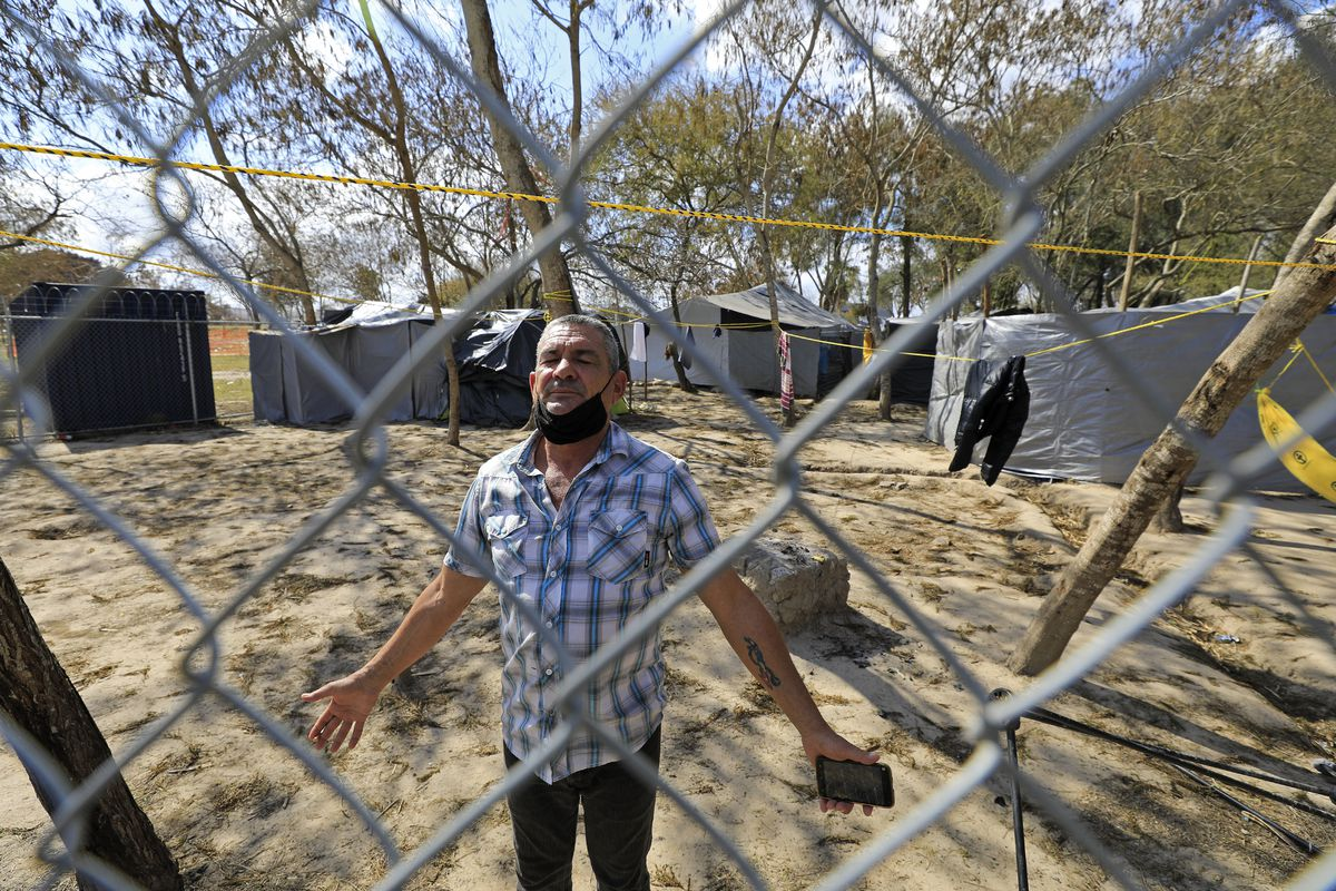 Cuban migrant Joel Fernandez Cabrera celebrates, Tuesday Feb. 23, 2021, to the news that migrants will be allowed into the U.S., at the migrant camp in Matamoros, Tamaulipas, Mexico.