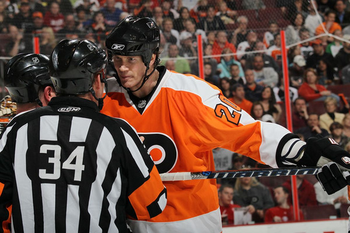 Chris Pronger and the refs wearing matching costumes.  You can tell by Pronger's face that he wishes they also had matching judgment.