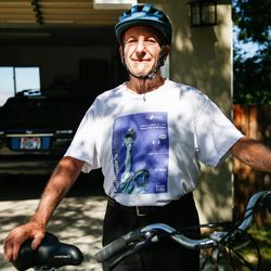 Lonnie Wollin poses for a portrait with his bike in front of his house in Cottonwood Heights on Saturday, July 11, 2020.