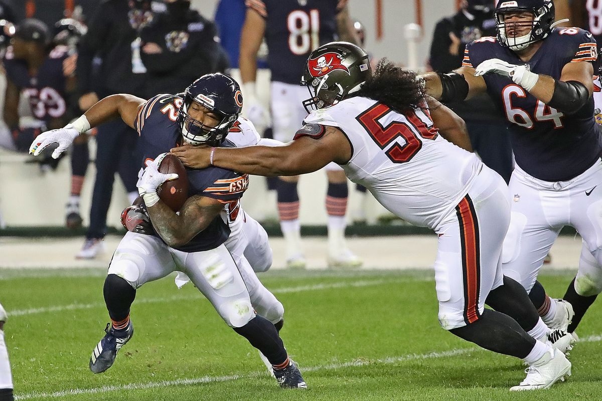 David Montgomery #32 of the Chicago Bears breaks away from Vita Vea #50 of the Tampa Bay Buccaneers at Soldier Field on October 08, 2020 in Chicago, Illinois. The Bears defeated the Bucs 20-19.