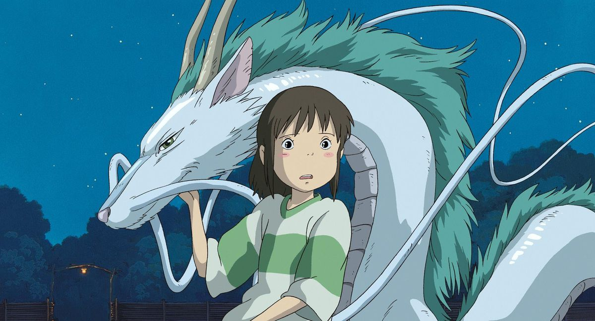 a young girl and a water dragon gasp at something off-screen in Spirited Away
