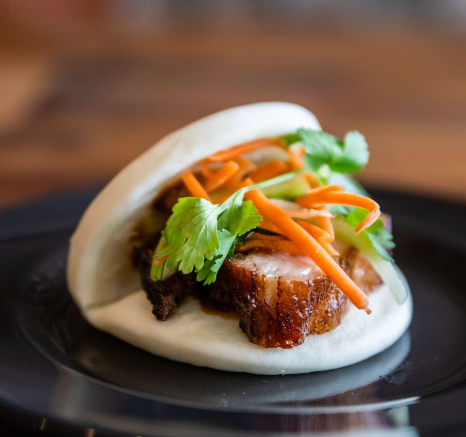 Pork belly bao with shredded carrots and scallions from Bun Belly