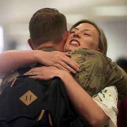 Sgt. Bradin Wilson hugs his sister Abbey Wilson at the Salt Lake International Airport in Salt Lake City on Tuesday, Aug. 27, 2019, as he and other members of the Utah National Guard's 4th Infantry Division Main Command Post Operational Detachment return home after serving in Afghanistan for 10 months in support of Operation Freedom's Sentinel.