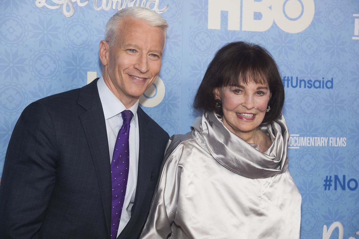"""FILE - In this April 4, 2016 file photo, CNN anchor Anderson Cooper and Gloria Vanderbilt attend the premiere of """"Nothing Left Unsaid"""" at the Time Warner Center in New York. Vanderbilt, the """"poor little rich girl"""" heiress at the center of a scandalous cus"""