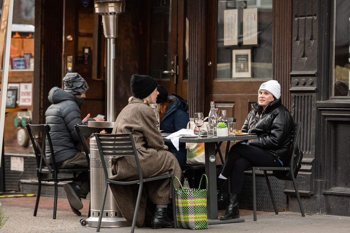 People wear coats while dining outside a restaurant in TriBeCa amid the coronavirus pandemic on January 28, 2021 in New York City.