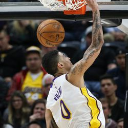 Los Angeles Lakers forward Kyle Kuzma (0) dunks during the game against the Utah Jazz at Vivint Smart Home Arena in Salt Lake City on Tuesday, April 3, 2018.