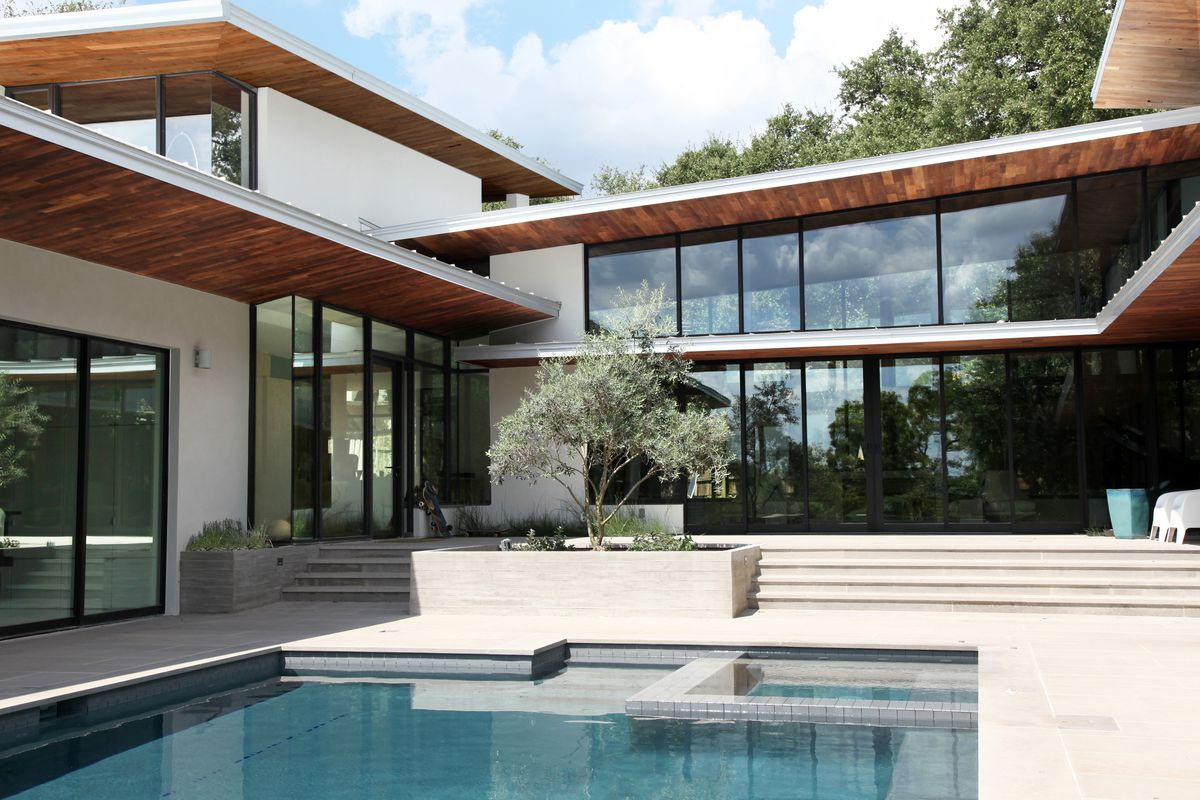Exquisite rollingwood contemporary drops price more than for Modern houses for sale austin