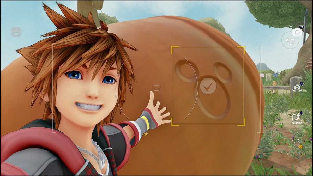 Sora smiles in front of a Lucky Emblem