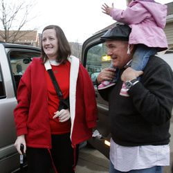 Clara Lewis smiles at numerous family and friends as she  returns home from the hospital in Centerville  Thursday, Dec. 29, 2011. Clara Lewis was severely injured in mid-November when her vehicle was struck by a FrontRunner train in Kaysville at a crossing. Her father Grant Taylor and her daughter Michaela, also in the accident,  are pictured with her.