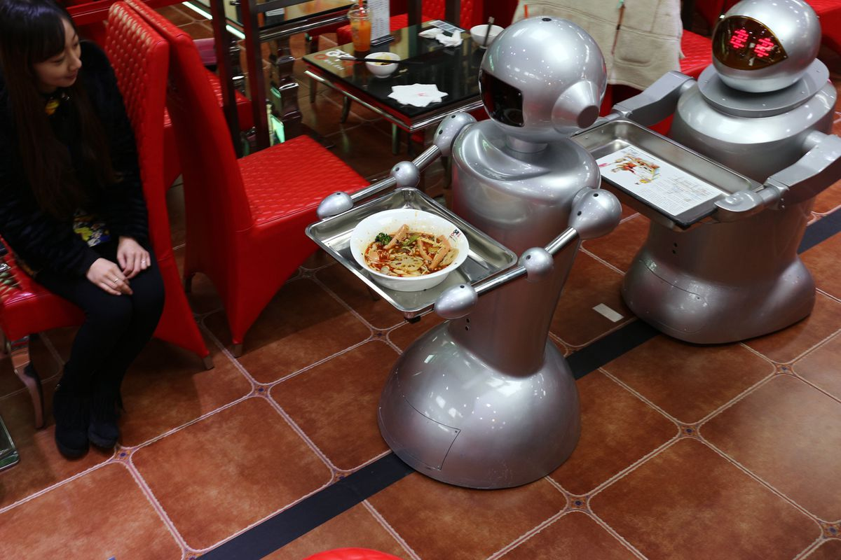 Waiters at another robot restaurant in Chengdu.