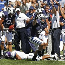 Weber State Wildcats running back Oran Maxwell (35) lies on the ground after fumbling  and Brigham Young Cougars linebacker Uona Kaveinga (4) celebrates during the first half as Brigham Young University plays Weber State University in football  Saturday, Sept. 8, 2012, in Provo, Utah.