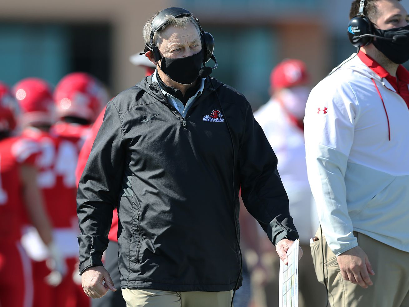 Naperville Central's head coach Mike Stine walks the sideline during his 100th win.