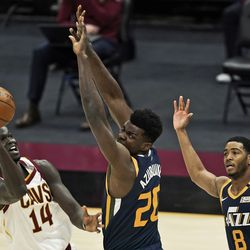 Cleveland Cavaliers' Thon Maker (14) shoots over Utah Jazz's Udoka Azubuike (20) and Shaquille Harrison (8) during the second half of an NBA basketball game Tuesday, Jan. 12, 2021, in Cleveland.