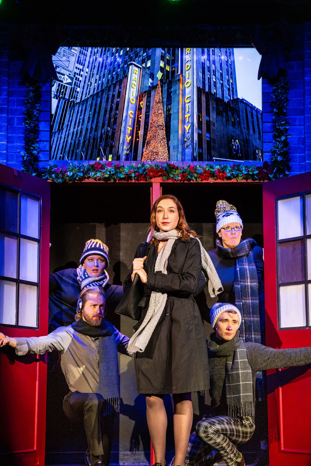 """Henrik Blix, Rob Grabowski, George Elrod, Bri Fitzpatrick, Jess DeBacco and Shelby Plummer in a scene from Second City's holiday revue, """"Deck the Hallmark: A Greeting Card ChannelOriginal."""""""