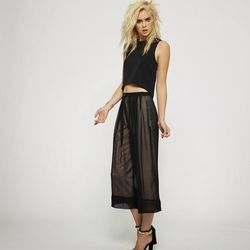 Avery Top in Black, $125; Cannes Gaucho Pants in Black, $180
