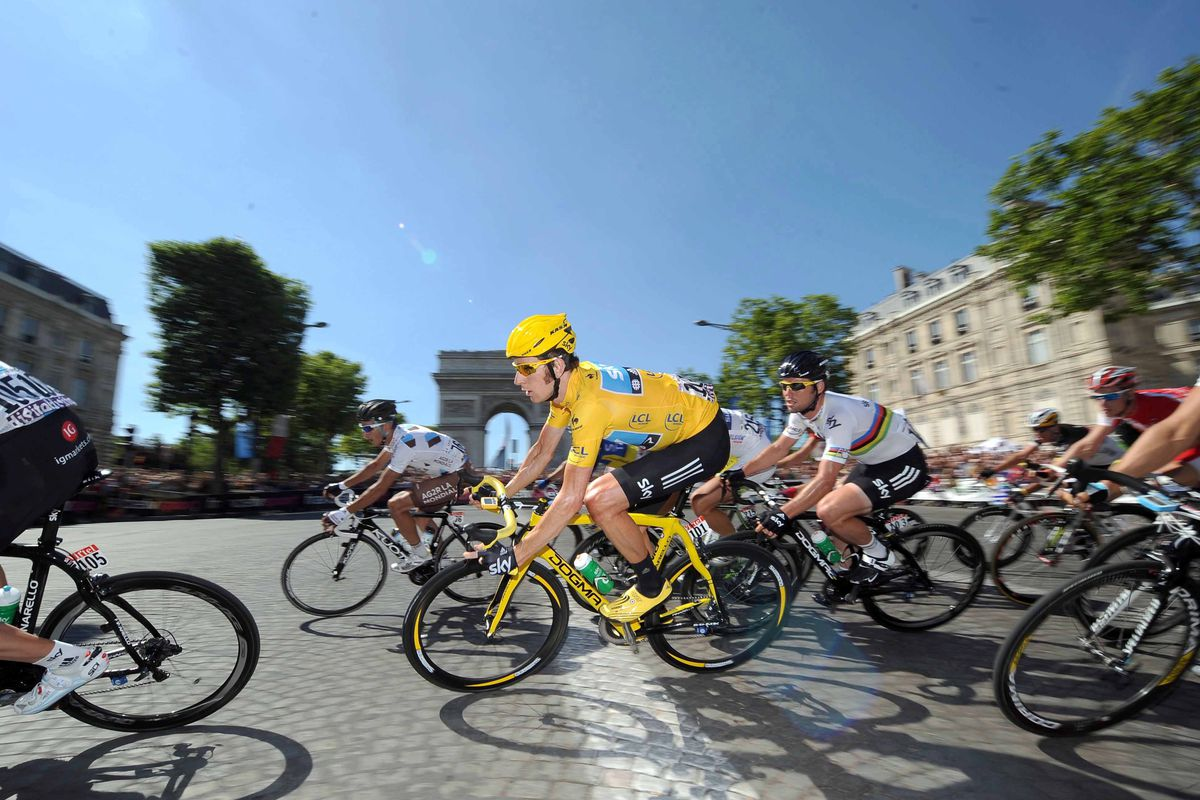 July 22, 2012; Paris, FRANCE; Bradley Wiggins (GBR), in yellow, and Mark Cavendish (GBR) during stage twenty of the 2012 Tour de France in Paris.  Mandatory Credit: Frederic Mons/Presse Sports via US PRESSWIRE