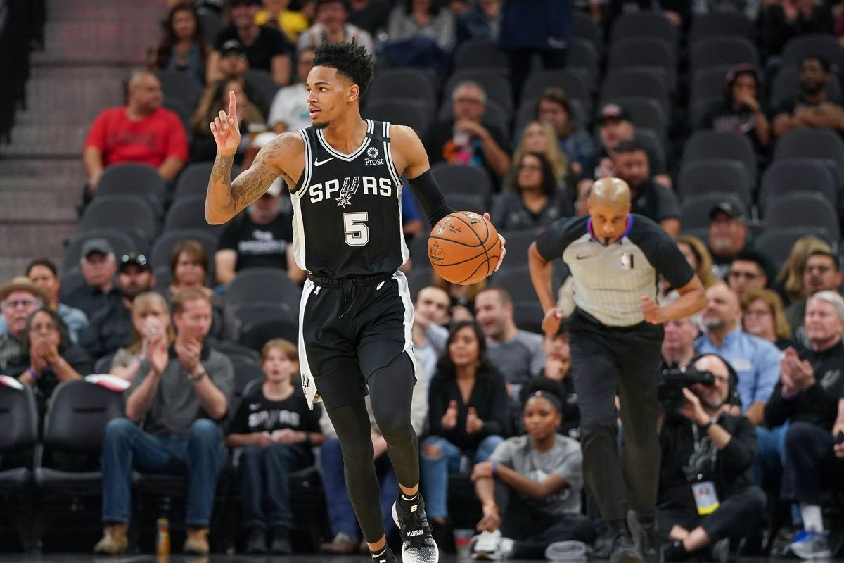 San Antonio Spurs guard Dejounte Murray brings the ball up the court in the first half against the Indiana Pacers at the AT&T Center.