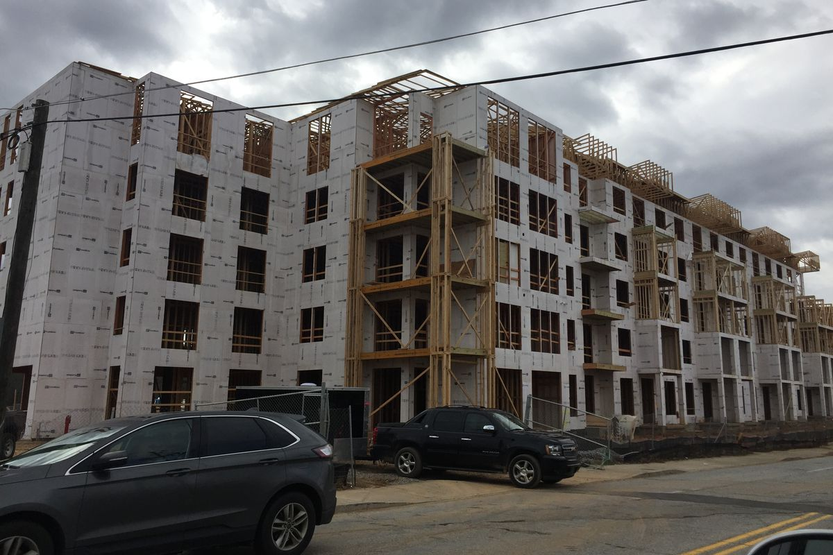 Framed out five-story apartment building.