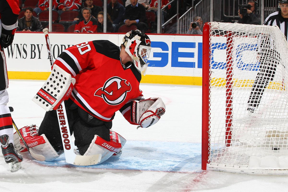NEWARK, NJ - DECEMBER 08:  Martin Brodeur #30 of the New Jersey Devils gives up a goal to Milan Michalek #9 of the Ottawa Senators during their game on December 8, 2011 at The Prudential Center in Newark, New Jersey  (Photo by Al Bello/Getty Images)