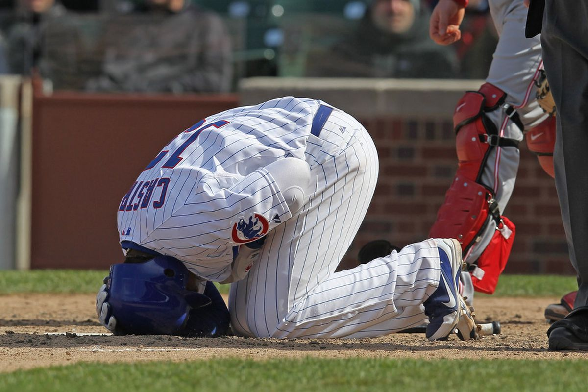 Starlin Castro of the Chicago Cubs reacts after being hit by a pitch against the Cincinnati Reds at Wrigley Field in Chicago, Illinois.  (Photo by Jonathan Daniel/Getty Images)