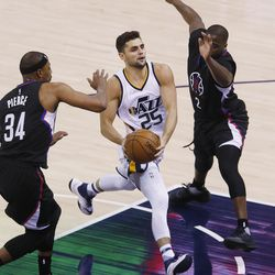 Utah Jazz guard Raul Neto (25) slips by LA Clippers forward Paul Pierce (34) during NBA playoffs game 4 in Salt Lake City on Monday, April 24, 2017. The Jazz won 105-98.