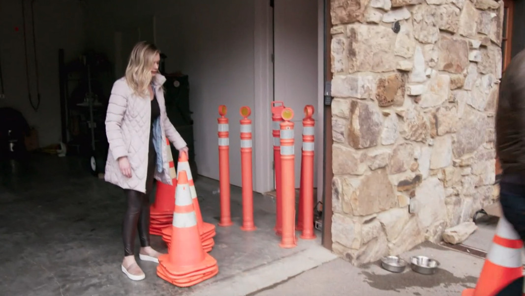 Kristin standing next to traffic cones and poles