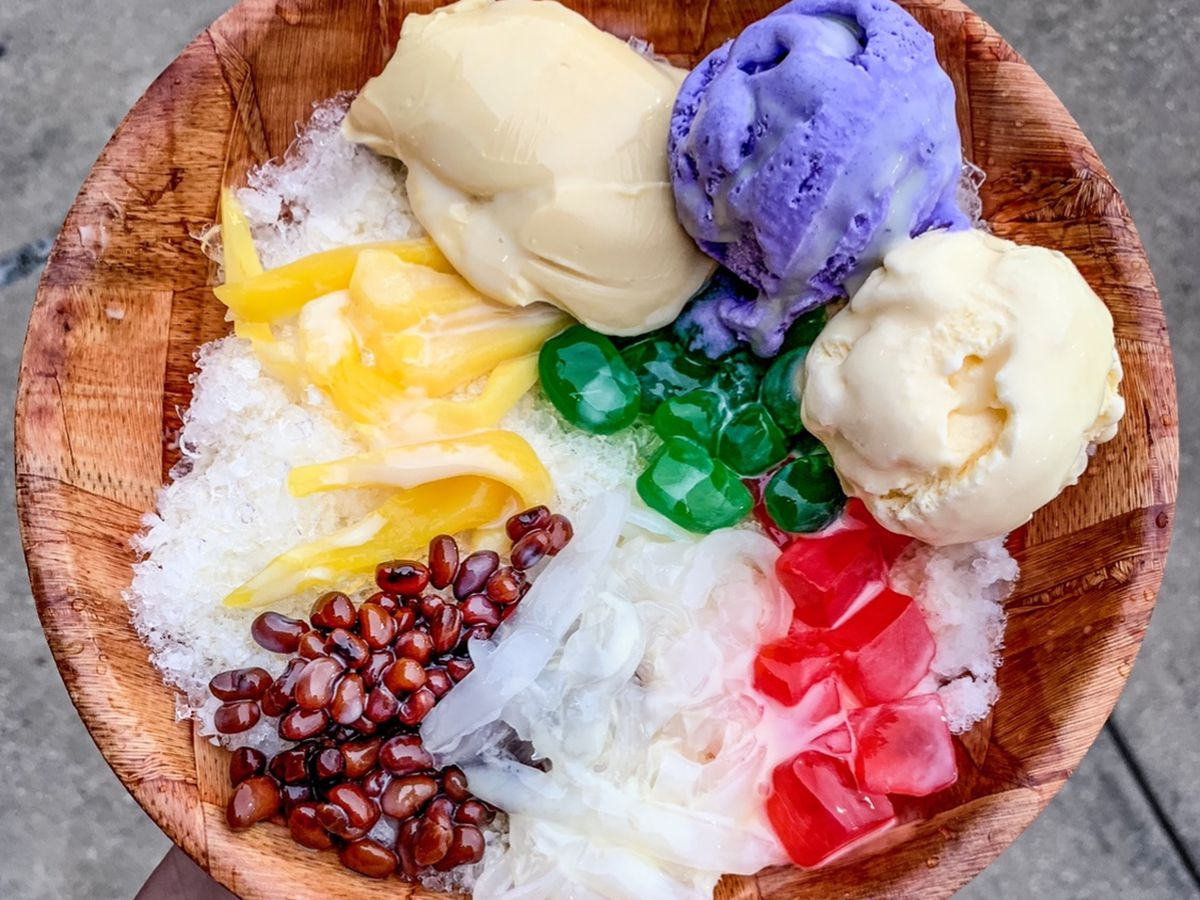 a wooden bowl filled with halo halo desert