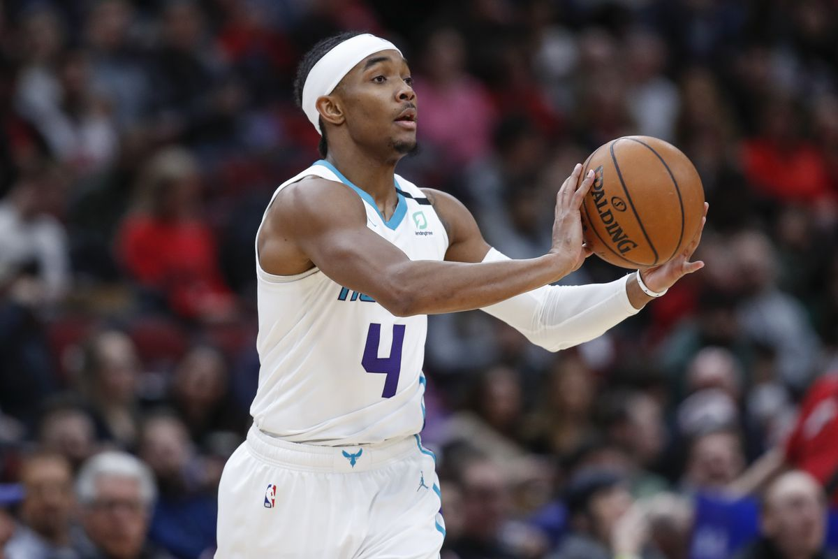 Charlotte Hornets guard Devonte' Graham looks to pass the ball against the Chicago Bulls during the second half at United Center.