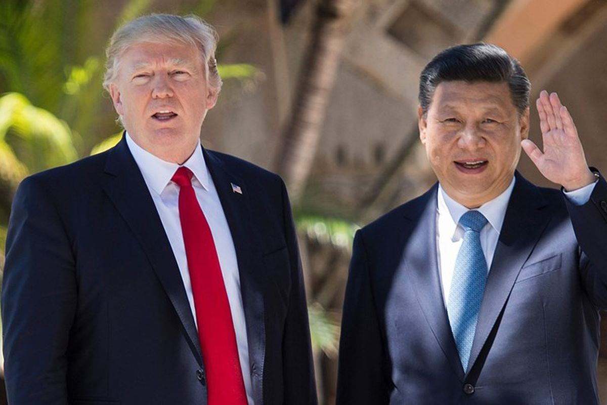 China's President Xi Jinping shakes hands with U.S. President Donald Trump at the Great Hall of the People in Beijing on Nov. 9, 2017.