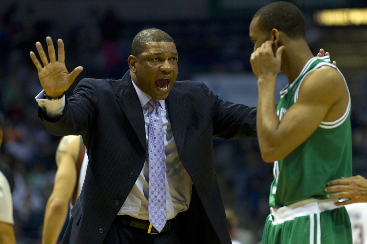 Mar 22, 2012; Milwaukee, WI, USA;  Boston Celtics head coach Doc Rivers gestures to guard Rajon Rondo during the second quarter  against the Milwaukee Bucks at the Bradley Center.  Mandatory Credit: Jeff Hanisch-US PRESSWIRE